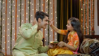 Young siblings celebrating Raskha Bandhan / Bhai Dooj festival together - Happy family