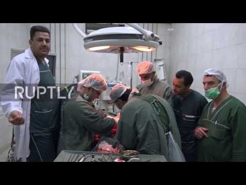 Syria: Russian doctors assist staff at Aleppo hospital