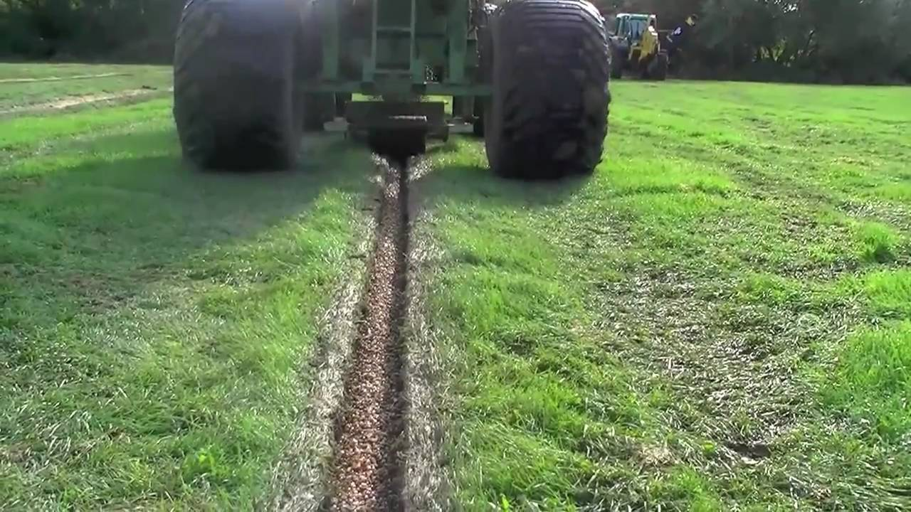 backfilling a drainage trench