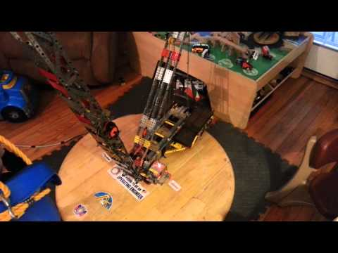 Toy steel erector crane picks up 3 year old
