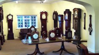 Antique Clocks - Antique Grandfather Clocks Striking At 12 O'clock.