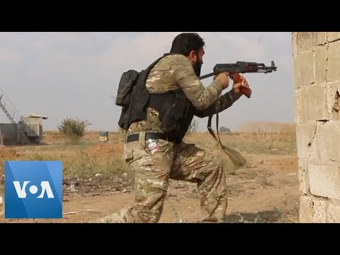 Turkey-Backed Fighters Clash with Kurds in Syria