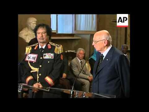 Libyan and Italian leaders hold talks; Berlusconi, protest