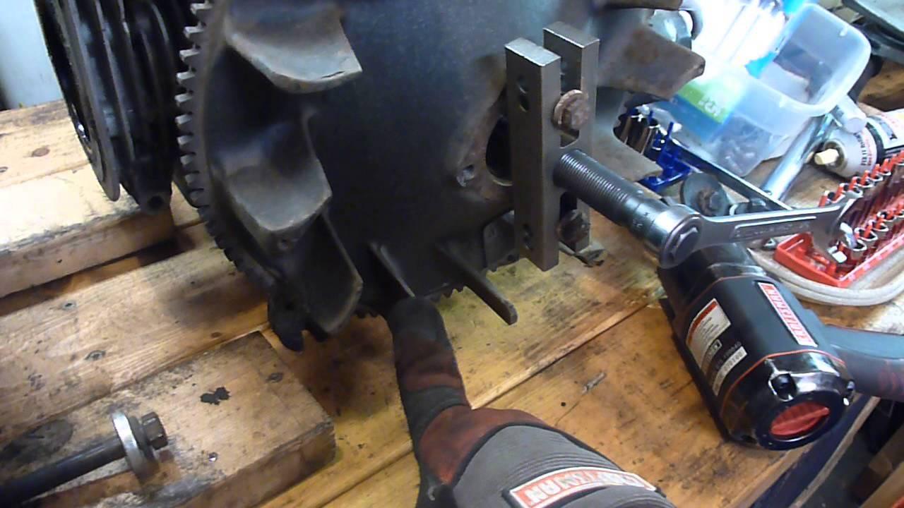 John Deere 318 Onan P218 Flywheel removal  YouTube