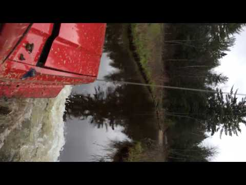 Lifted Jeeps XJ and TJ Cross Water on Trail in Maine