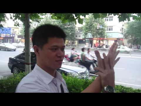MALAYSIA STREET HYPNOTIST IN CHINA WITH TOM SILVER HYPNOTIZING PEOPLE WALKING DOWN STREET
