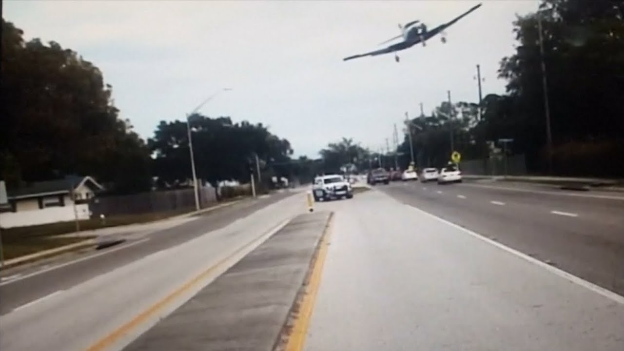 Dashcam video shows plane crash-landing in Florida – video