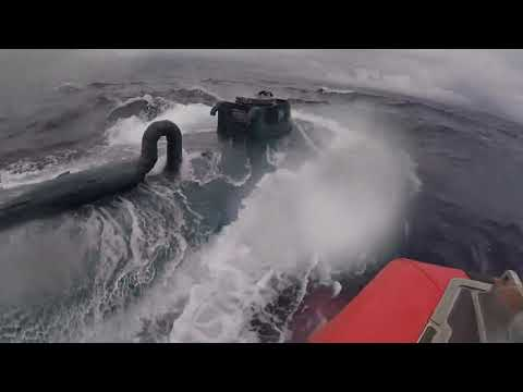 Watch This U.S. Coast Guard Member Surf Suspected Narco-Submarine