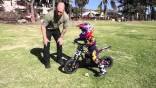 Kid Riding Oset 12.5 Electric Trials Bike