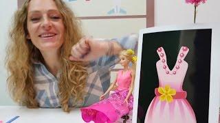 Ein neues Kleid für Barbie. Video für Mädchen.