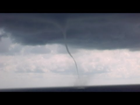 Cruise Ship sails between TORNADO FUNNEL CLOUDS! Close Call!