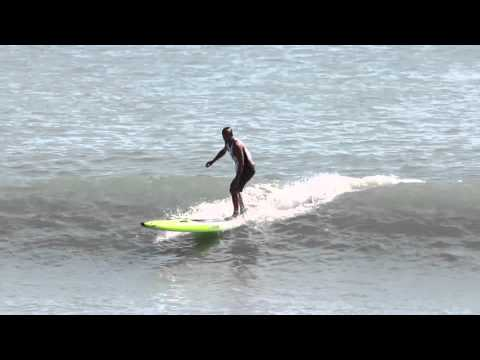 Colin McPhillips surfing a prone paddleboard at the Pacific Paddle Games