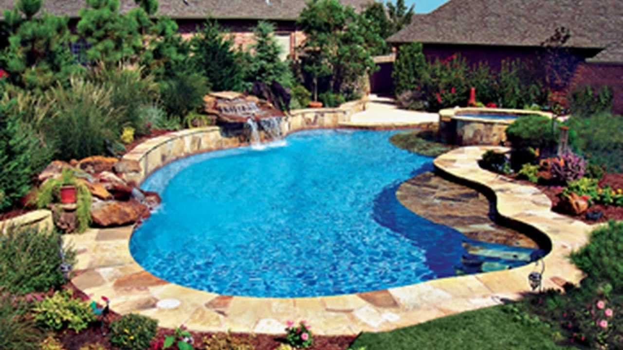 super cool inground swimming pools by bluehaven custon gunite pool waterfall builders youtube