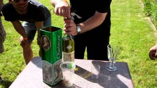 Uncorking a bottle of Absinthe Pernod Fils circa 1960 s at the 2014 Boveresse Absinthe Festival