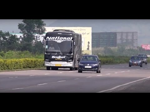 Volkswagen Car & Multi Axle Scania Bus In A Parallel Race At High Speed On Pune - Mumbai Expressway