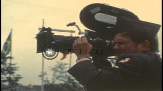 A US Army cameraman clicks pictures with his camera during the 1972 Summer Olympi...HD Stock Footage
