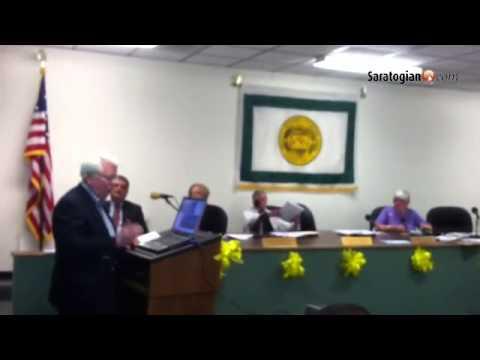 Jonesville Cemetry Brd of Trustees Pres.  Ed Hughes announces cemetery is on National Register of Hi