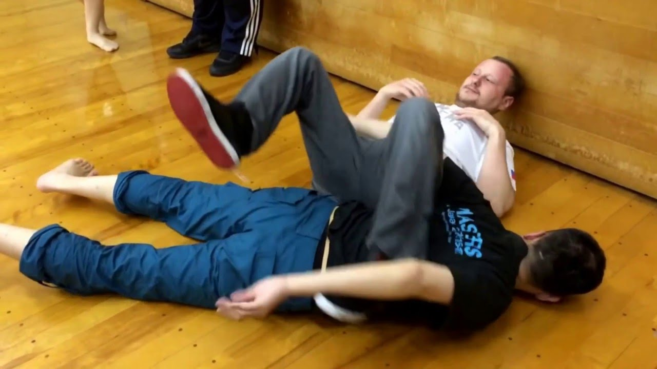 """Role play demo """"attacked in the sleeping situation"""" by Master Mikhail & his son Daniil Ryabko."""