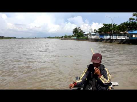 Motorbikes on a boat - Crossing a river in Makassar, Indonesia