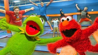 kermit the frog and elmo have fun at a trampoline park