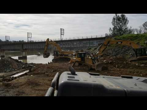 Unloading  dirt off the barges from the spillway in Oroville, California