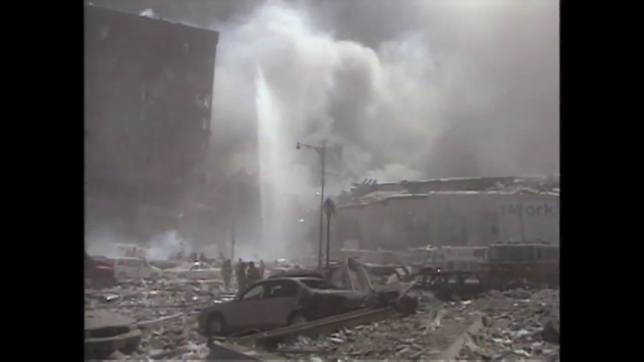 Download Cameraman caught in aftermath of Twin Towers collapse on 9/11