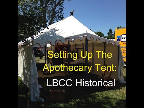 Setting up the Historical Apothecary Shop Tent