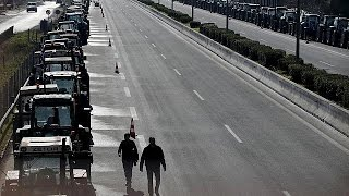 Greek farmers block Athens airport highway junction with tractors