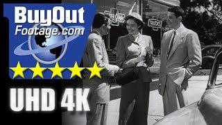 USA 1950s: Car Salesman with Young Couple