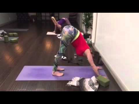 Forrest yoga controlled jump to handstand