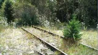abandoned buildings & railroad tracks in a possible ghost town: henderson, michigan