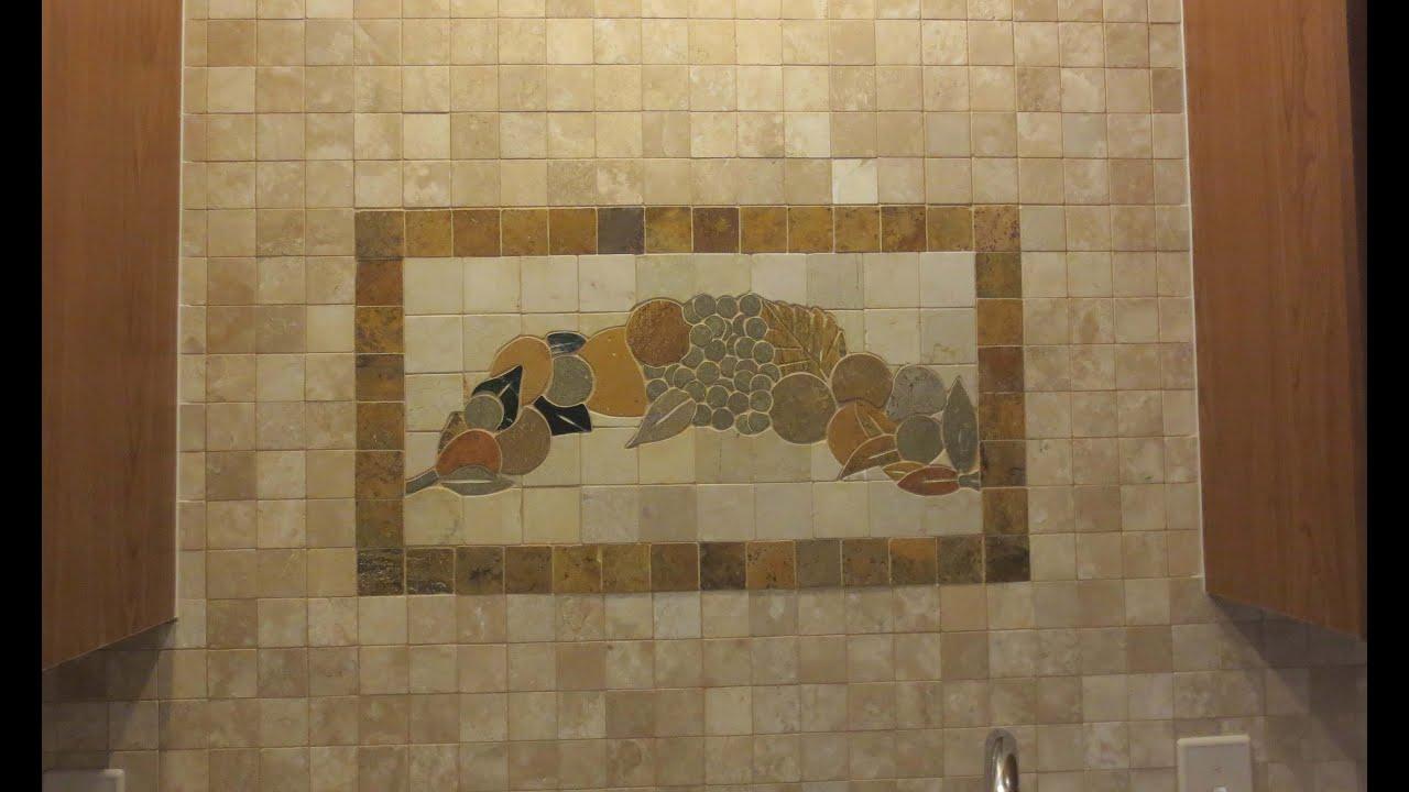 Time lapse travertine mosaic tile backsplash with plaque
