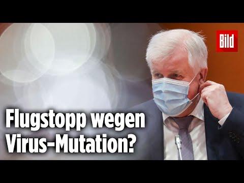 Seehofer und Merkel wollen Flüge nach Deutschland einschränken