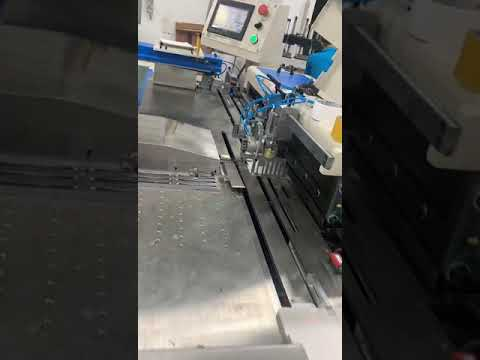 Automatic YO hole punching machine by Shenzhen Colorfine Printing Co., Ltd