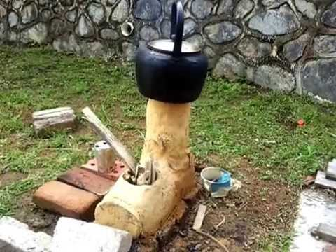 Top Feed Clay Rocket Stove Boiling Water And Cooking