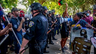 See Black Lives Matter protesters clash with Trump supporters at defund police rally