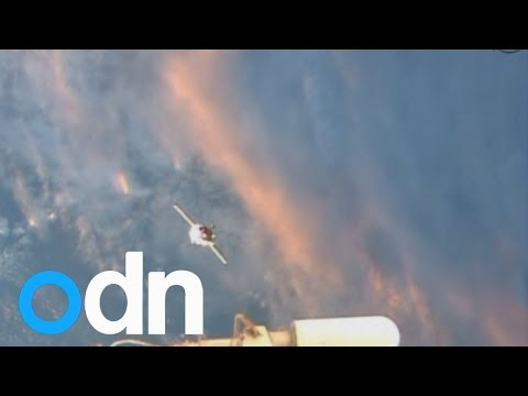 Trio in Soyuz rocket dock at International Space Station