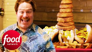 Casey Chows Down An Insane Helping Of Fully Loaded Hotdogs | Man v Food
