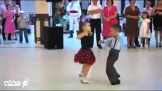 Cute kids dancing at a wedding