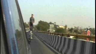 Indian Dude Rides Motorcycle Standing up!  on a HIghway!