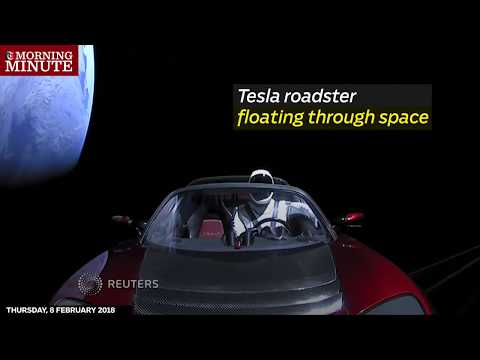 Tesla roadster floating through space