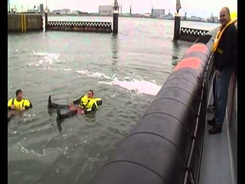 jumping in the cold  water from KNRM rescue boat