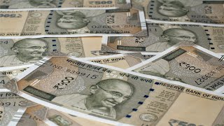 Closeup shot of Rupee 500 Indian currency notes falling on the table