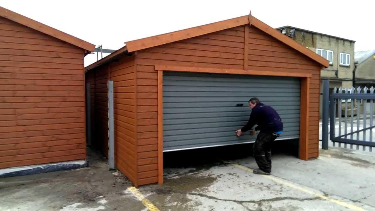 Wooden garage with manual roller roor in action youtube for R value of old wood garage door