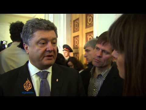 Ukraine scraps protest laws as PM steps down