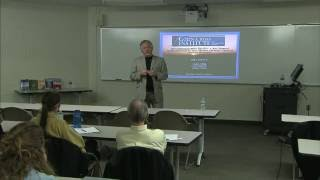 Colin Ross, M.D. speaking on trauma at Aquinas College