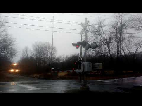 New England central 608 blasts through the rain in Mansfield Depot Connecticut