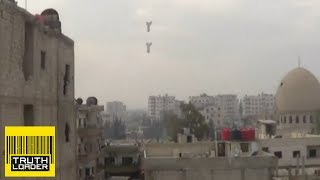 Bomb explosion filmed from metres away in Syria - Truthloader