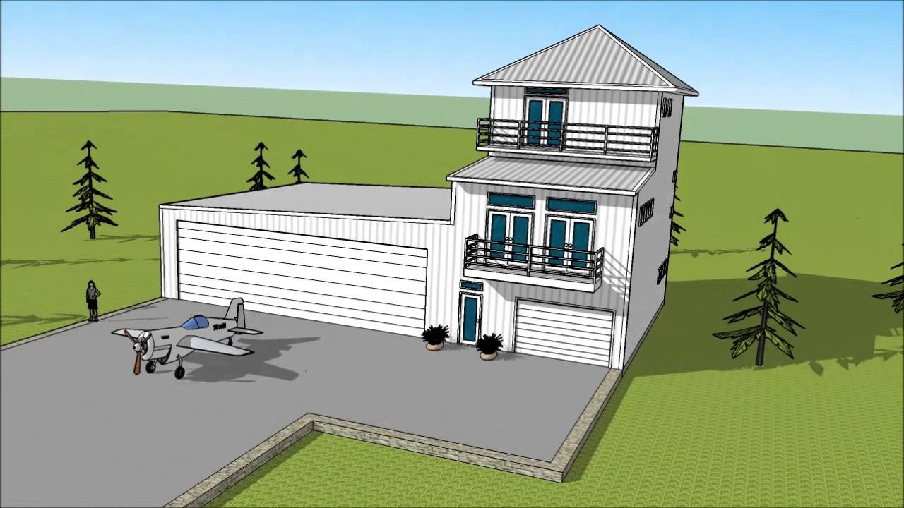 metal building three story condo attached to airplane hangar
