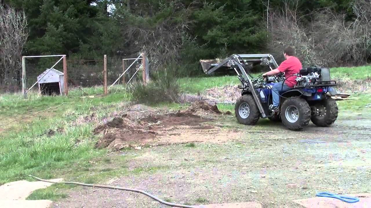 ATV FRONT END LOADER digging into the ground and scooping up dirt and  gravel (Hydraulic)